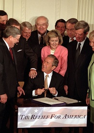 President Bush signing a $1.35 trillion tax cut into law, June 7, 2001