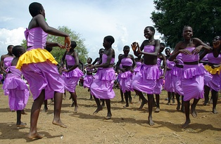 Ugandan youth dance at a cultural celebration of peace