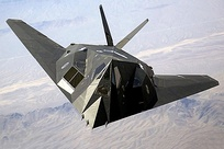F-117 Nighthawk flying over mountains in Nevada in 2002
