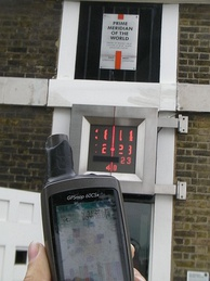 Handheld GPS receiver indicating the Greenwich meridian is 0.089 arcminutes (or 5.34 arcseconds) west to the WGS 84 datum