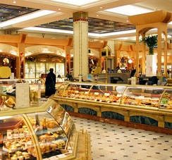 The retail servicescape includes the appearance, equipment, display space, retail counters, signage, layout and functionality of a retail outlet. Pictured:Harrods food court