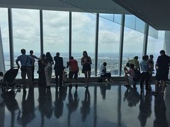Visitors looking toward New Jersey from One World Observatory