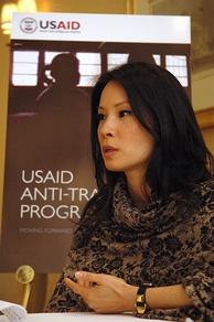 Lucy Liu speaking at a 2009 USAID event raising awareness about human trafficking