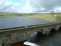 Grassholme Reservoir and Bridge, Lunedale. The flat grass hill on the horizon is in fact the dam of Selset Reservoir.