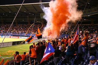 Puerto Rico Islanders fans at a soccer game.