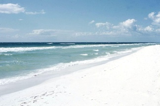 The color of the sand in the region is exceptionally white, as seen in this 1957 photo at Pensacola Beach, Florida, adjacent to the protected area designated in 1971.