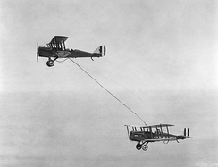 Capt. Lowell Smith, and Lts. John Richter, Virgil Hine, and Frank Seifert conduct first mid-air refueling, June 27, 1923