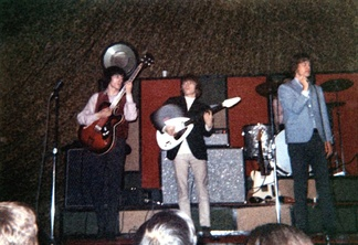 In the Rolling Stones, shown here in 1965, the rhythm section consisted of electric guitar, electric bass, and drums, who provided the beat and chords for lead singer Mick Jagger to sing over.