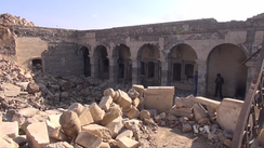 Photograph of the ruins of the mosque of Yunus, following its destruction by ISIL