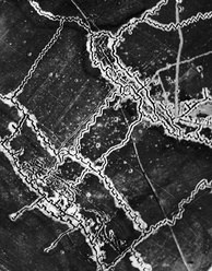 British aerial photograph of German trenches north of Thiepval, 10 May 1916, with the German forward lines to the lower left. The crenellated appearance of the trenches is due to the presence of traverses.