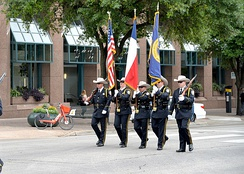 The TABC honor guard participates in a peace officers memorial service near the Texas Capitol in Austin.
