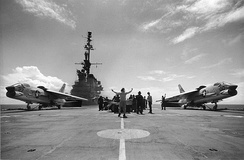 "Two Crusaders prepare to launch from USS Midway; their variable-incidence wings are in the ""up"" position."