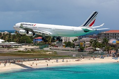 An Air France Airbus A340-300 flying over Maho Beach shortly before touch-down