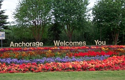 "The ""Anchorage Welcomes You"" sign outside Ted Stevens Anchorage International Airport. The city is known for showcasing abundant flowers during the summer months."