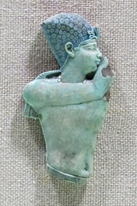 Egyptian faience torso of a king, for an applique on wood