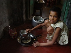 Child maid servant in India. Child domestic workers are common in India, with the children often being sent by their parents to earn extra money, although it is banned by the government.