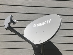 A 4K Reverse Band Slimline 3 DirecTV satellite dish with a multi-satellite LNB on a ground pole.
