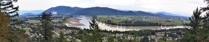 Panoramic view of Fraser River and valley as seen from the grounds of Westminster Abbey, above Hatzic in Mission, British Columbia.
