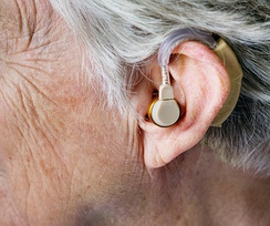A person wearing in-the-ear hearing aid