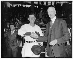 Harris and Connie Mack shaking hands in 1938