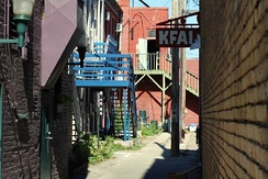 KFAI and the back entrance to old buildings with brightly colored woodwork