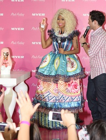 "Minaj promoting her first fragrance, ""Pink Friday"", in 2012"