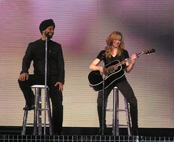 "Singer Yitzhak Sinwani (left) lent his vocals on the song ""Isaac"". He also joined Madonna during some performances on the Confessions Tour."