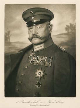 An old photograph of a man with a moustache in military uniform.