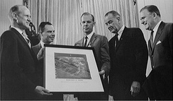 An image taken during the Mariner 4 Mars flyby is presented to the U.S. President