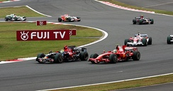 Sébastien Bourdais and Felipe Massa battling for position early on in the 2008 Japanese Grand Prix. They later made contact, for which the Toro Rosso driver was penalised.