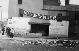 Loyalist graffiti and banner on a building in a side street off the Shankill Road, Belfast (1970)