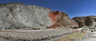 Thrust fault in the Qilian Shan, China. The older (left, blue and red) thrust over the younger (right, brown).