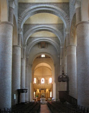 The Church of St Philibert, Tournus, (990–1019) has tall circular piers supporting the arcade and is roofed with a series of barrel vaults supported on arches. Small clerestory windows light the vault.