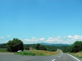U.S. Route 211 as it passes through Rappahannock County; the Blue Ridge Mountains can be seen in the distance.