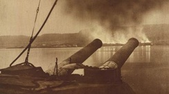 View of Gallipoli from the battleship HMS Cornwallis. The smoke is coming from the British and Commonwealth stores being burned during the evacuation.