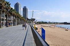 Part of the beach promenade and the beach of La Barceloneta towards Port Olimpic