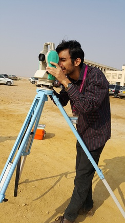 A student using a theodolite in field