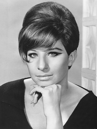 Barbra Streisand became the youngest winner in 1970 at the age of 28. However her Tony is a non-competitive award.