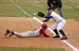 Pickoff attempt on runner (in red) at first base