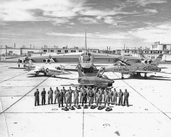 4925th Test Group (Nuclear) at Kirtland Air Force Base in New Mexico. In addition to two B-47s (not pictured), the group's fleet included two Boeing B-52s (one is pictured in the rear) and three fighters — from left, a Lockheed F-104, a Fiat G-91, and a North American F-100.