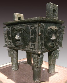 Bronze square ding (cauldron) with human faces.