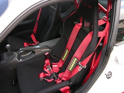 Bucket seat combined with a Schroth 6-point harness