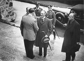 Adolf Hitler greets British Prime Minister Neville Chamberlain on the steps of the Berghof, 15 September 1938 during the crisis over Czechoslovakia. Joachim von Ribbentrop stands on the right.