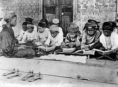 Children studying Qur'an in Java, Indonesia, during colonial period