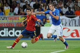 Chiellini (right) challenges Cesc Fàbregas of Spain during the UEFA Euro 2012 Final.