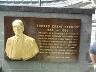 "A plaque commemorating ""Edward Grant Barrow"" attached to a marble wall"