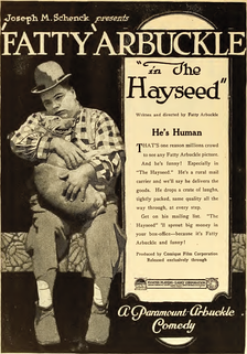 Ad for The Hayseed (1919) with Arbuckle holding his dog Luke
