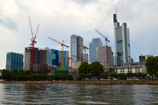 Frankfurt's skyline from across the Main, showing construction cranes