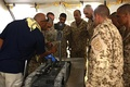 A robotics technician assigned to the Bahraini Special Security Force (BSSF) trains soldiers on the SUGV