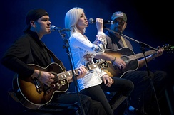 Pickler and members of her band Ryan Ochsner, left, and Joshua Henson perform for U.S. service members during the first stop of the 2008 USO Holiday Tour on Ramstein Air Base, Germany, December 16, 2008